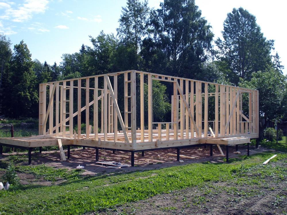 фото : Строительство деревянного дома на свайном фундаменте